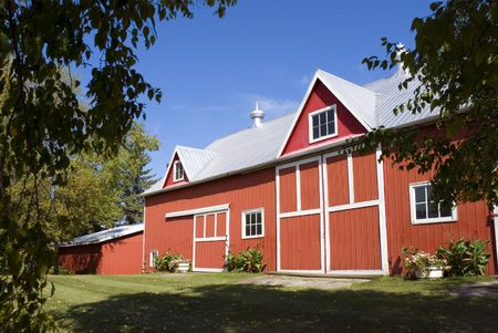 pitched roof: A classic North American red barn in early fall. Stock Photo