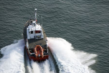 motor officer: A patrol boat shot from above while travelling fast. Stock Photo