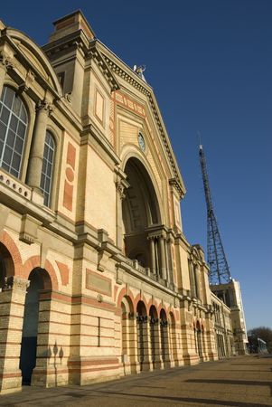 alexandra: The facade of the Great Hall at Alexandra Palace in North London, with the BBC antenna visible on the right.
