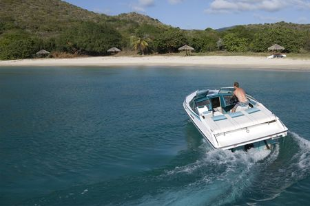 A speedboat in the turquoise waters of the Caribbean. photo