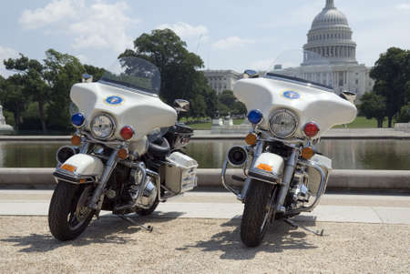 a white police motorcycle: Two Secret Service motorcycles parked in front of The Capitol in Washington, DC.