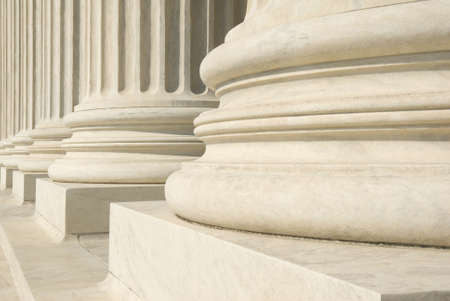 A row of columns at the entrance to the US Supreme Court in Washington, DC. photo