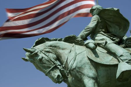 A detail of the Ulysses S. Grant Memorial with Old Glory flying in the background. (The Grant Memorial includes the largest equestrian statue in the United States.) Stock Photo - 2625152