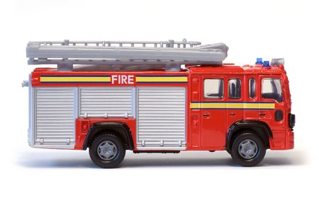 playthings: A toy London fire engine.
