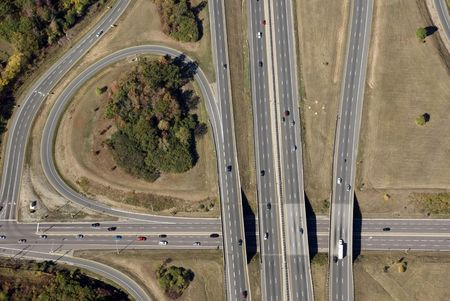 merging: An aerial view of a North American freeway interchange in late summer. (Some of the faster moving cars have very slight motion blur.)