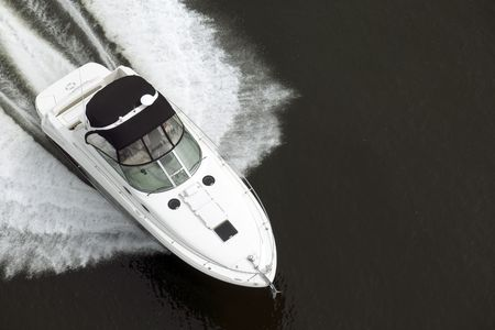 A black and white speedboat shot from above while travelling fast. Stock Photo - 3003727