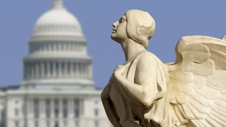lobbying: The winged figure of Democracy in front of the United States Capitol in Washington, DC. Stock Photo