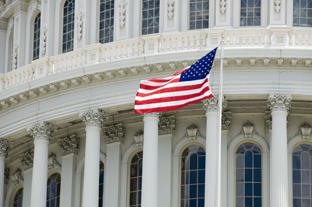capitol building: The flag of the USA flying in front of the Capitol building in Washington, DC.