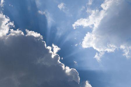 cirrus: Sunlight radiating through banks of cumulus clouds. Stock Photo