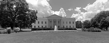 A black and white panorama of the north face of the White House in Washington, DC. photo