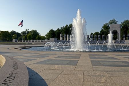 The US National World War II Memorial in early morning.  The memorial is dedicated to Americans who served in the armed forces and as civilians during World War II. Consisting of 56 pillars and a pair of arches surrounding a plaza and fountain, it is loca