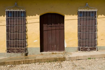 The entrance to a Spanish colonial era house on a cobbled street in Trinidad, Cuba.