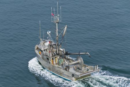 A commercial fishing boat heading into the northern Pacific.