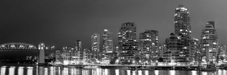 A black and white panorama, with an aspect ratio of 3:1, of False Creek in Vancouver at nighttime, in British Columbia, Canada. photo
