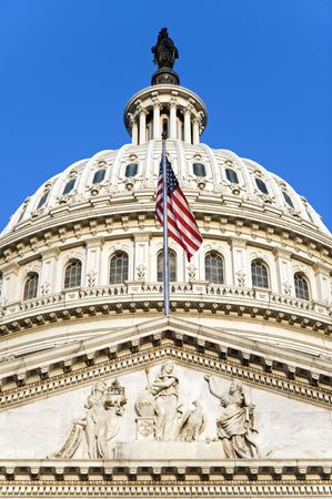 The flag of the USA flying on the east side of the Capitol building in Washington, DC, shortly after dawn. photo
