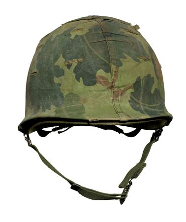 army soldier: A US military helmet with an M1 Mitchell pattern camouflage cover from the Vietnam war. Stock Photo
