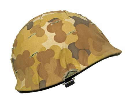 A US military helmet with an M1 Mitchell cloud pattern, or autumn-winter, camouflage cover. It was first issued in 1953 just as the Korean war ended. photo