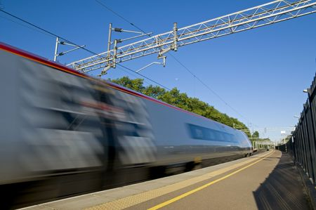 A British high speed passenger train passing through a station in the early morning. Stock Photo - 7845718