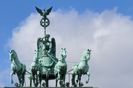 The Brandenburg Gate Quadriga in Berlin, Germany. Quadrigas were emblems of triumph; Victory and Fame often are depicted as the triumphant woman driving the chariot.
