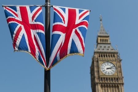 union jack flag: Two Union Flags flying in front of the clock tower, commonly referred to as Big Ben, of the Palace of Westminster.