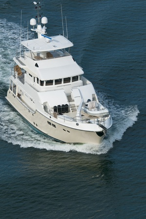cruiser: A luxury yacht moving through calm water in the Pacific Ocean. Stock Photo
