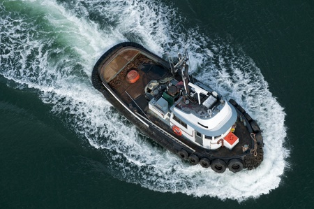 A tough little tugboat seen from above.