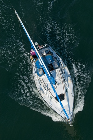 wake wash: A sailing boat shot from above. Stock Photo