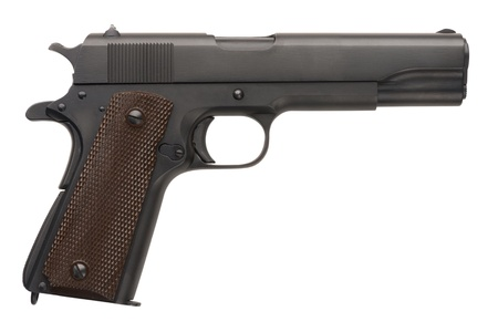 sidearm: An unissued American-made .45 1911A1 semi-automatic military pistol from World War Two.