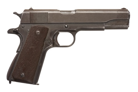 A well used American-made .45 1911A1 semi-automatic military pistol from World War Two.  Stock Photo