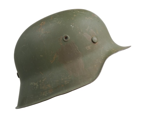 eliminated: A German World War Two (Stahlhelm M1942) military helmet. The M1942 design was a result of wartime demands. The rolled edge on the shell was eliminated to simplify production. Stock Photo