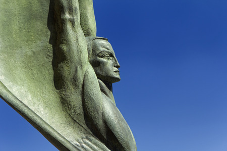 A detail of one of the two Winged Figures of the Republic on the Nevada side of the Hoover Dam.  Stock Photo