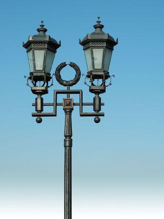 ornate street lamp on blue sky photo