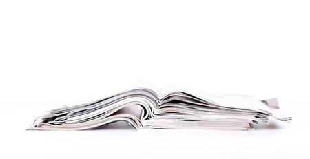 gazette: Batch of open magazines, close-up