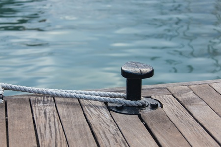 Yachting - Mooring rope tied around steel anchor
