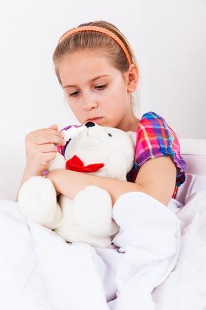 Cute girl doctor with teddy bear Stock Photo - 22795777