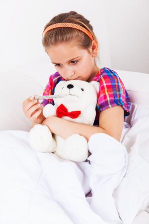 Cute girl doctor with teddy bear Stock Photo - 22795778