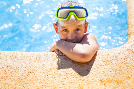 Happy girl with goggles relaxing in swimming pool Stock Photo - 29918114