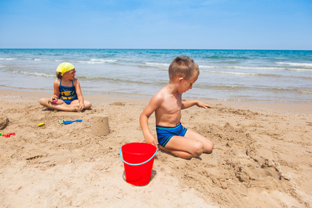 Kids playing on the beach and building sandcastle Stock Photo - 29918116