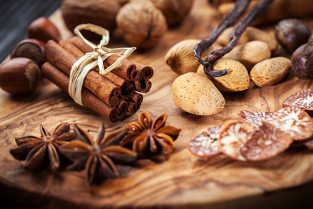 Christmas spices, nuts and baking ingredients photo