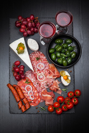 Antipasto and catering platter with different appetizers photo