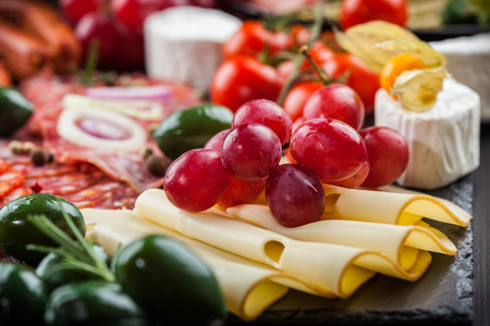 italian sausage: Antipasto and catering platter with different appetizers Stock Photo