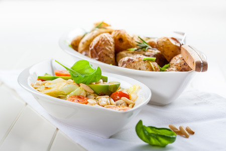 the calorie: Low calorie cabbage salad with avocado and oven potatoes Stock Photo
