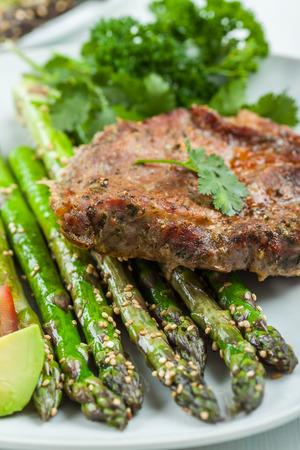 grilled pork chop: Glazed green asparagus with sesame seeds and grilled pork chop
