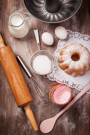 Baking utensils with marble cake photo