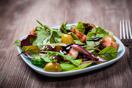 low calories: Mixed low calorie salad with olives and fresh avocado