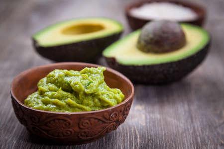 salsa: Guacamole with avocado on wooden table