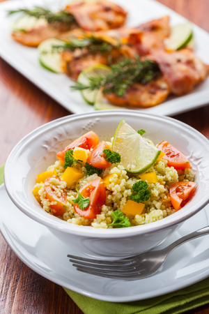 moroccan cuisine: Fresh couscous salad for summer with tomato, pepper with olives