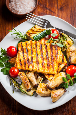 haloumi: Halloumi grilled cheese on mushrooms and vegetables Stock Photo