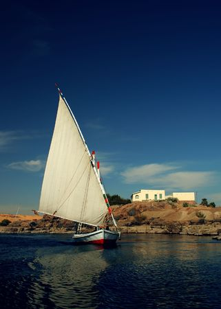 nile: A traditional felucca on the river Nile at Aswan, Egypt.