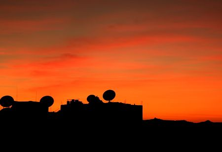 Satellite Dishes silhouetted against the dusk sky. photo